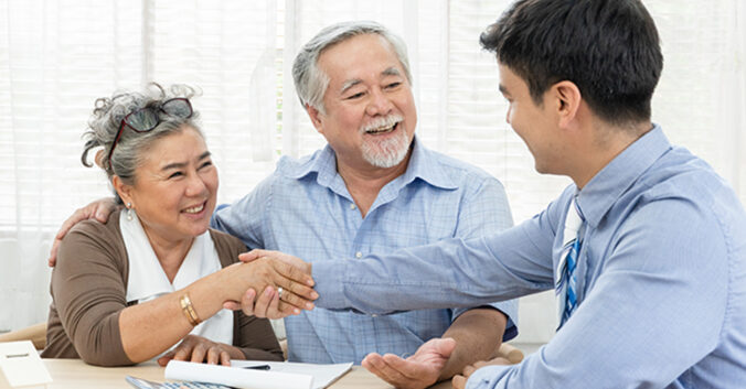 shaking hands after acquiring dental insurance